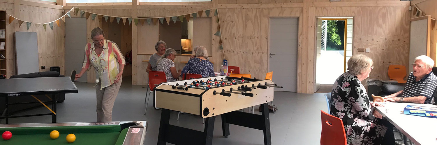 People talking and playing table tennis